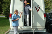 Dr. Van Horn welcoming a patient into the mobile vet clinic