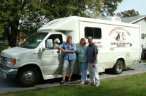 Dr. Janet Van Horn, Linda, and Frank by the Convenient Care Mobile Veterinary Clinic Van